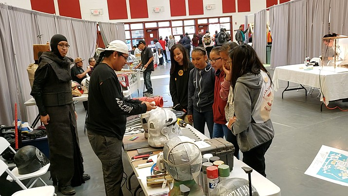 Cosplayer Kirk Tom of Farmington, New Mexico displays costume fabrication creations at the inaugural Diné Maker Nation Faire. Tom will be returning this year. (Photo courtesy of Navajo Technical University)
