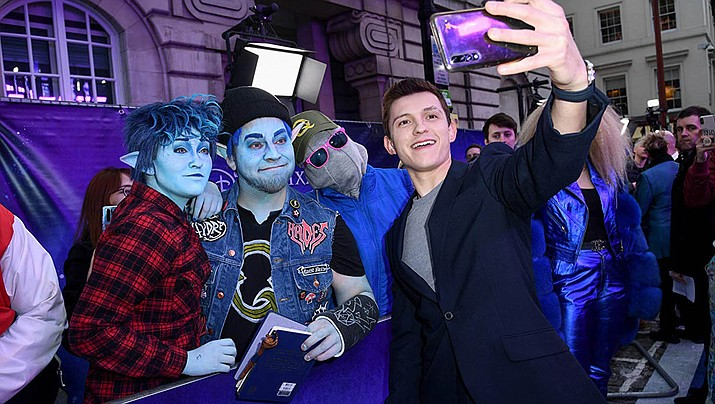 """Tom Holland is shown at an event in advance of the release of the Pixar movie """"Onward."""" (IMDb photo)"""