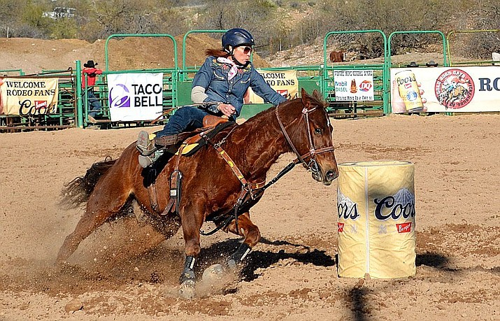 Leisa Brug whipped around a series of barrels. She's got her sights and spurs set on a few rounds in the Prescott Frontier Days Rodeo this summer. (Aaron Ricca/Courtesy)