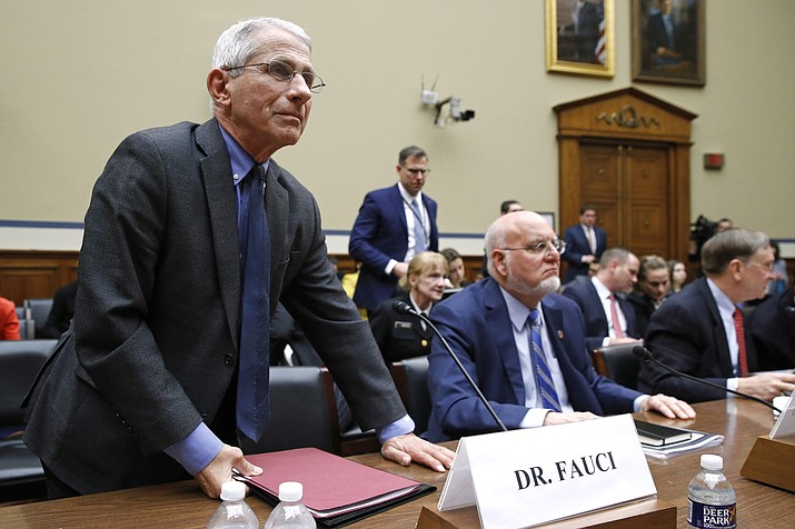 Dr. Anthony Fauci, left, director of the National Institute of Allergy and Infectious Diseases, departs during a recess after testifying before a House Oversight Committee hearing on preparedness for and response to the coronavirus outbreak on Capitol Hill in Washington, Wednesday, March 11, 2020. Sitting alongside Fauci is Dr. Robert Redfield, director of the Centers for Disease Control and Prevention. (Patrick Semansky/AP)