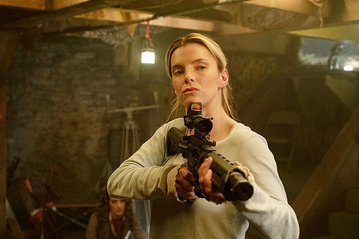 "This image  shows Betty Gilpin in a scene from ""The Hunt."" (Patti Perret/Universal Pictures via AP)"