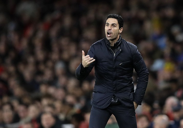 In this Sunday, Feb. 23, 2020 photo Arsenal's head coach Mikel Arteta shouts out from the touchline during the English Premier League match between Arsenal and Everton at Emirates stadium in London. Arsenal manager Mikel Arteta has tested positive for the coronavirus, forcing the club to close its training complex and put the entire first-team in self isolation. For most people, the new COVID-19 coronavirus can cause only mild or moderate symptoms, but for some it can cause more severe illness. (Kirsty Wigglesworth/AP, file)