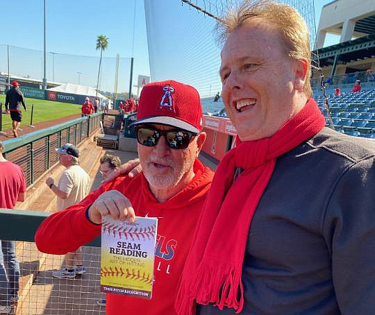 "Dennis Tiefenthaler, right, has met briefly with Los Angeles Angels manager Joe Maddon to discuss Tiefenthaler's 2020 book titled, ""Seam Reading: The Hidden Art of Hitting,"" during Spring Training in the Phoenix area. Tiefenthaler and his son, Jared, co-wrote the book, which quotes Maddon saying, ""You are better reading seams than you are guessing what pitch is coming next."" (Courtesy/Tiefenthalers)"