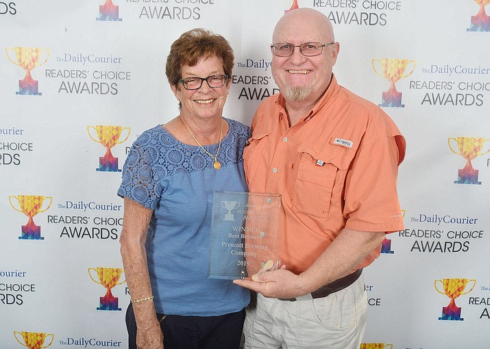 """Roxane and John Nielsen pose with their """"Best Brewery"""" award at the 2019 Readers' Choice Awards. (Les Stukenberg/Courier, file)"""