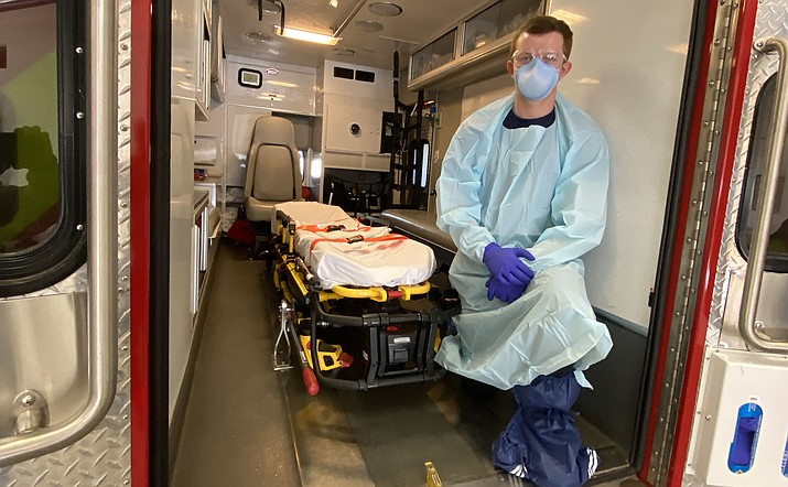 Copper Canyon EMT Brady Elliott wears personal protective equipment when responding to a call in which a patient exhibits one of these three symptoms: fever, cough or shortness of breath. Although these are symptoms of COVID-19, they are not exclusive to the coronavirus. VVN/Bill Helm