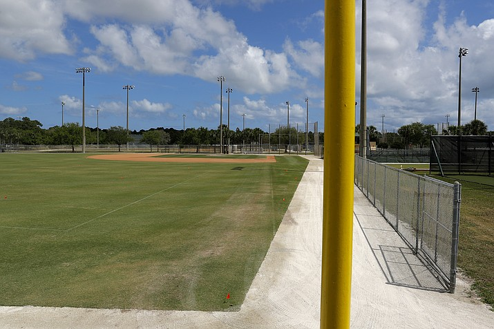 An empty practice field is seen at the Miami Marlins spring training baseball facility, Monday, March 16, 2020, in Jupiter, Fla. On Sunday night, the Centers for Disease Control and Prevention recommended gatherings of 50 people or more be canceled or postponed across the country for the next eight weeks. Major League Baseball planned to update teams Monday on its health policy.(Julio Cortez/AP)