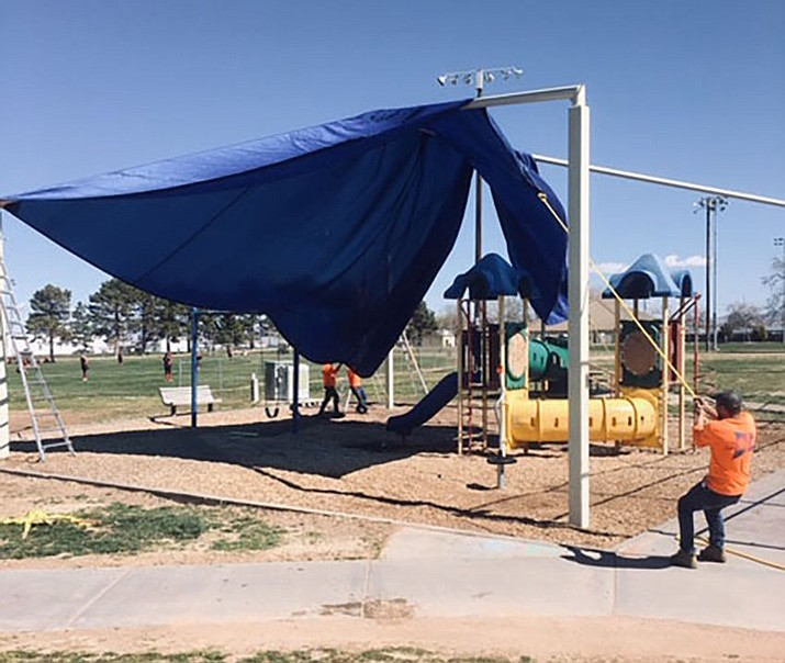 A shade structure is shown being installed at Centennial Park in Kingman. While some events and leagues have been suspended due to the coronavirus pandemic, residents are still able to use city parks. (file photo)