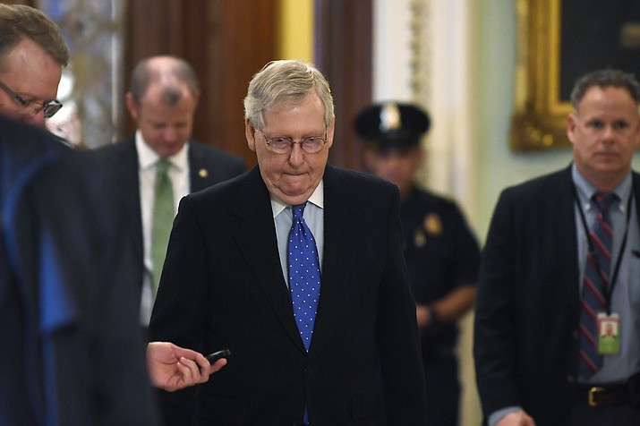 Senate Majority Leader Mitch McConnell of Ky., walks back to his office on Capitol Hill in Washington, Tuesday, March 17, 2020. (Susan Walsh/AP)