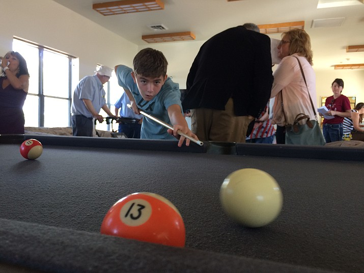 Phoenix Lane shoots some pool during the open house and registration event of the Chino Valley Teen Center Thursday, Aug. 6, 2019. (Jason Wheeler/Review)