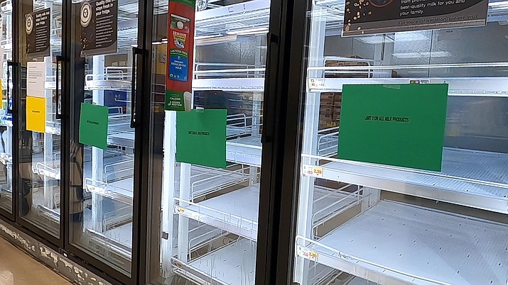 Empty shelves for milk are seen at the Fry's in Prescott Valley on Tuesday, March 17, 2020. Shelves at grocery stores in Prescott and Prescott Valley remain empty, despite being restocked regularly. (Jesse Bertel/The Daily Courier)