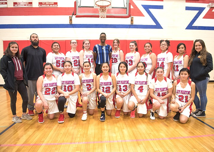 The girls basketball team poses with Grand Canyon Phantoms coach Catheryn Redmond and assistant Coach Jesse Magana. The Lady Phantoms caused a major upset at the 1A State Championship tournament at Finlay Toyota Center in Prescott Valley Feb. 20 when they knocked out No. 1 St. David in a quarterfinal game. (Veronica R. Tierney/WGCN)