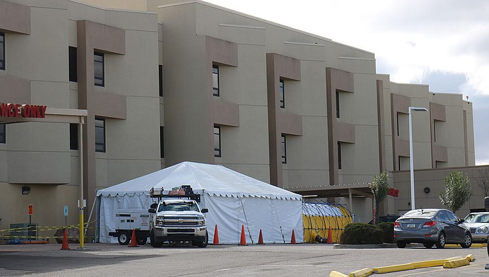 A tent has been set up outside the Kingman Regional Medical Center Emergency Department where doctors screen all patients coming in with respiratory illnesses or symptoms. (Photo by Travis Rains/Kingman Miner)