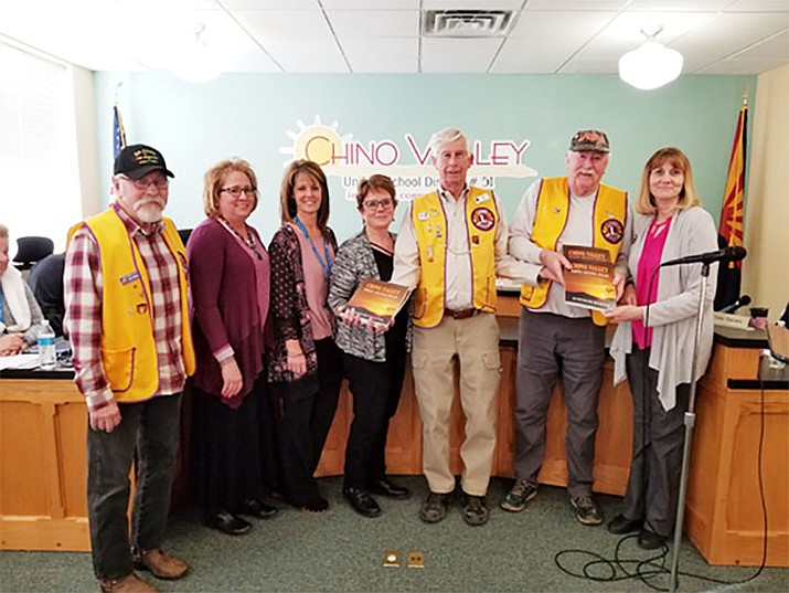 The Chino Valley Morning Lions Club donates copies of the town's new 50-year anniversary book to Chino Valley Unified School District libraries.(Wil Williams/Courtesy)