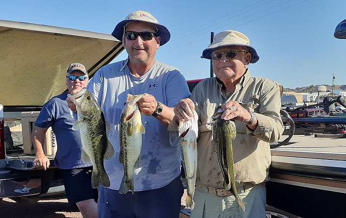 The father-and-son team of Dave and Dave Hilton show off a few of the bass that helped them win the Kingman Bass Club tournament at Martinez Lake on the lower Colorado River. (Courtesy photo)