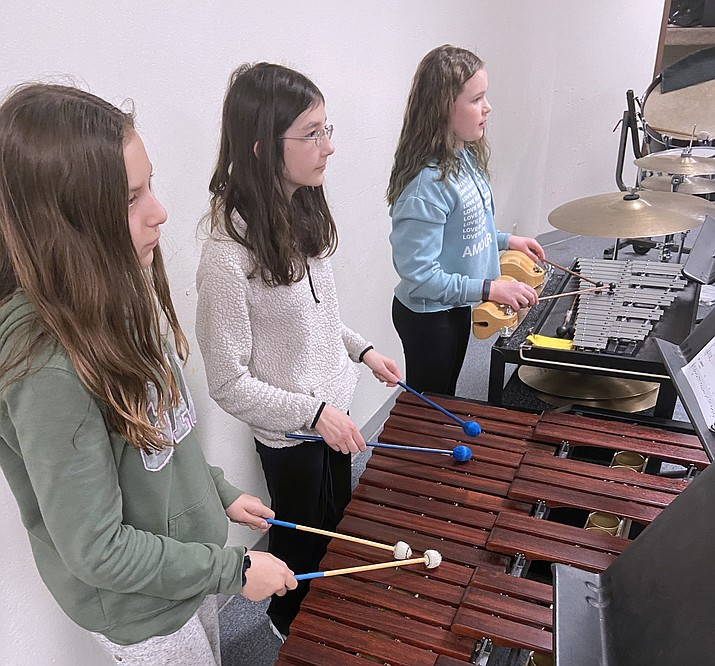 Sierra Oswald, Audrey Stearns and Addy Endicott play new percussions instruments at WEMS March 12. (Wendy Howell/WGCN)
