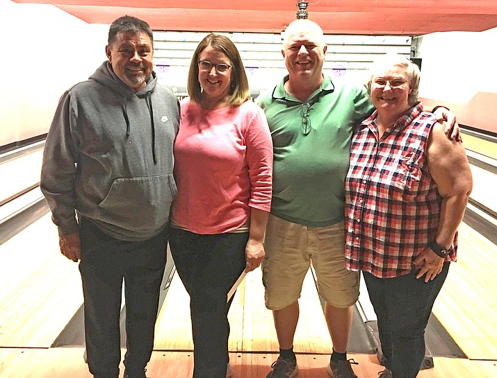 Team Y ASK Y won $100 as the Four Rollers Bowling League season winners. From left: Andrew Aldaz, Julie Aldaz, Pete Jones and Sheila Jones. (Submitted photo)