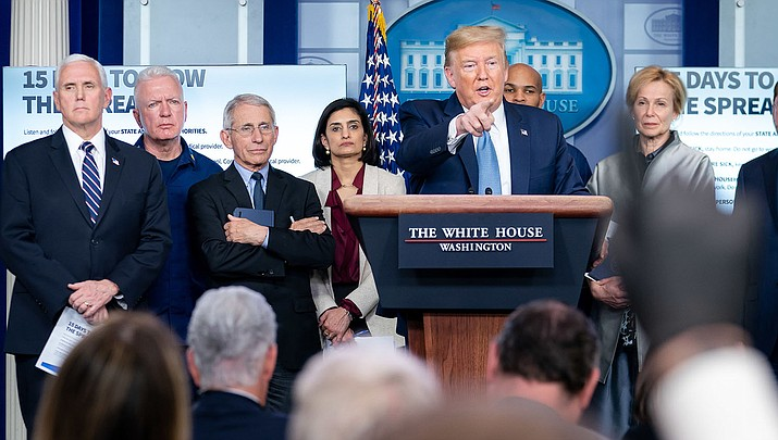 U.S. President Donald Trump takes questions during a press conference backed by health officials and Vice President Mike Pence. The White House is seeking an $850 economic stimulus package in response to the coronavirus. (Official White House photo/public domain)