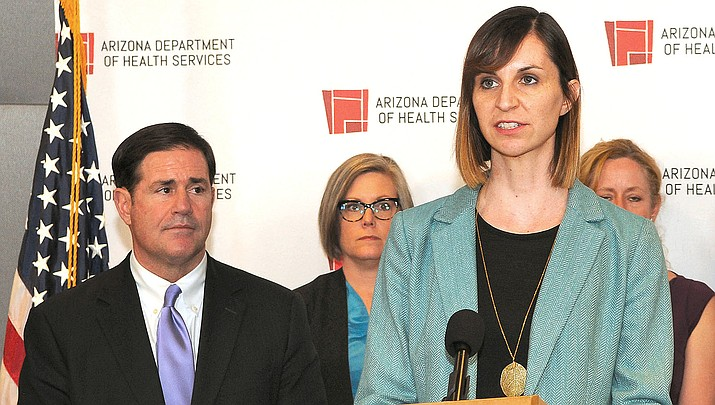 State schools chief Kathy Hoffman discusses Monday, March 16, what might happen if schools cannot reopen before the end of the school year. With her is Gov. Doug Ducey. (Capitol Media Services photo by Howard Fischer)