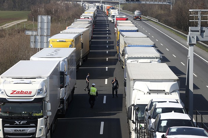 Trucks stand on the highway close to the border between Austria and Hungary near Bruck an der Leitha, Austria, Wednesday, March 18, 2020. Hungary has closed the border due to the new coronavirus outbreak. Only for most people, the new coronavirus causes only mild or moderate symptoms, such as fever and cough. For some, especially older adults and people with existing health problems, it can cause more severe illness, including pneumonia. (Ronald Zak/AP)