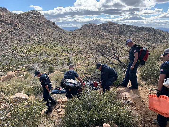 Prescott Fire Department personnel carry an unconscious man down Granite Mountain Tuesday, March 17. (PFD/Courtesy)