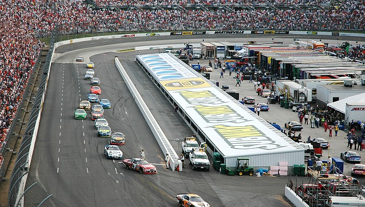 NASCAR drivers won't be back on the track until May 9 at Martinsville Speedway, above, in Virginia. NASCAR is still trying to find a way to cram the postponed events and the All-Star race into the crowded 36-race schedule could be difficult. (Photo by Art10, Public Domain)