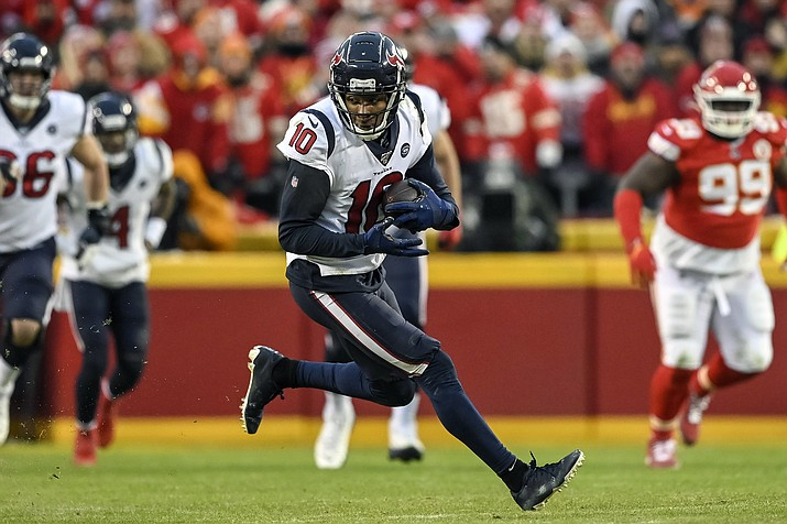 In this Jan. 12, 2020, photo, Houston Texans wide receiver DeAndre Hopkins (10) runs against the Kansas City Chiefs during the second half of an NFL football game in Kansas City, Mo. (Reed Hoffmann/AP, file)
