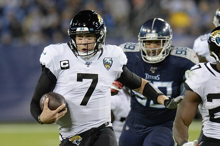 In this Nov. 24, 2019, photo, Jacksonville Jaguars quarterback Nick Foles (7) scrambles against the Tennessee Titans in the second half of an NFL football game in Nashville, Tenn. (Mark Zaleski/AP, file)
