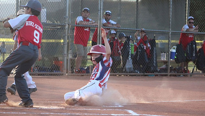 Canton Collins slides into home during Kingman North Little League's win over Kingman last year. Collins and his teammates will have to wait until May 11 to start playing this season. (Miner file photo)