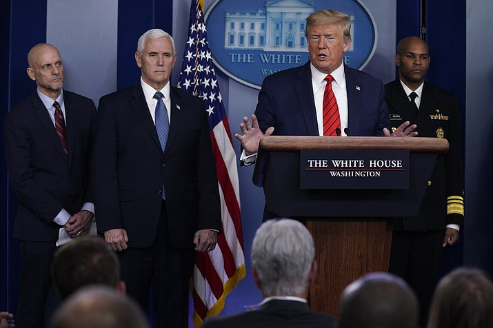 President Donald Trump speaks during press briefing with the coronavirus task force, at the White House, Thursday, March 19, 2020, in Washington. From left, Food and Drug Administration Commissioner Dr. Stephen Hahn, Vice President Mike Pence, Trump, and Surgeon General Jerome Adams. (Evan Vucci/AP)