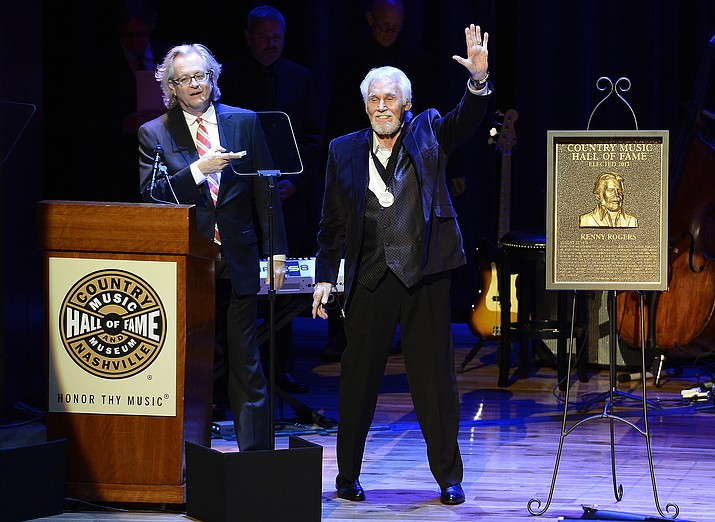 "In this Oct. 27, 2013 photo, country music star Kenny Rogers thanks the audience at the ceremony for the 2013 inductions into the Country Music Hall of Fame in Nashville, Tenn. Actor-singer Kenny Rogers, the smooth, Grammy-winning balladeer who spanned jazz, folk, country and pop with such hits as ""Lucille,"" ""Lady"" and ""Islands in the Stream"" and embraced his persona as ""The Gambler"" on record and on TV died Friday night, March 20, 2020. He was 81. (Mark Zaleski/AP, File)"