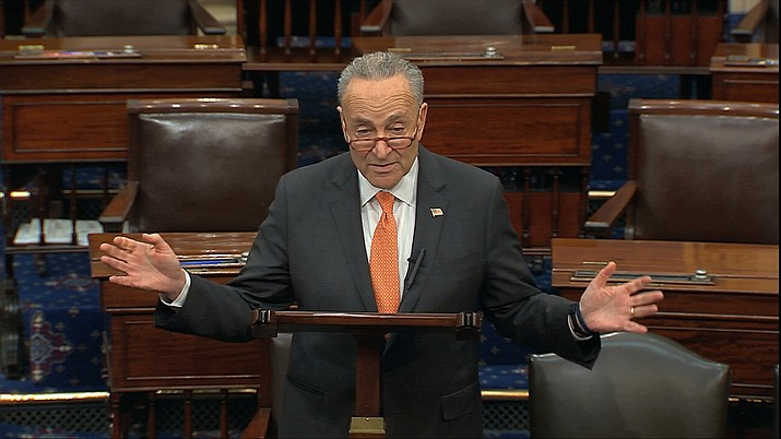 In this image from video, Senate Minority Leader Chuck Schumer, D-N.Y., speaks on the Senate floor at the U.S. Capitol in Washington, Saturday, March 21, 2020. (Senate Television via AP)