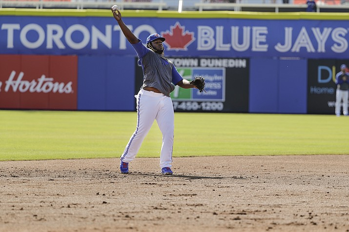 Toronto Blue Jays' Vladimir Guerrero Jr. warms up before a spring training baseball game against the Pittsburgh Pirates Monday, March 2, 2020, in Dunedin, Fla. (AP Photo/Frank Franklin II)