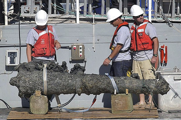 In this Oct. 26, 2011, file photo, researchers led by the N.C. Department of Cultural Resources' Underwater Archaeology Branch rest a recovered 2,000-pound cannon on the back of a NOAA research vessel from the wreck of the pirate Blackbeard's ship, which has been on the ocean floor off the North Carolina coast for nearly 300 years in Beaufort, N.C. The Supreme Court has agreed to hear a copyright dispute that grew out of the discovery of the pirate Blackbeard's ship off North Carolina's coast. (Chuck Beckley/The Jacksonville Daily News via AP)