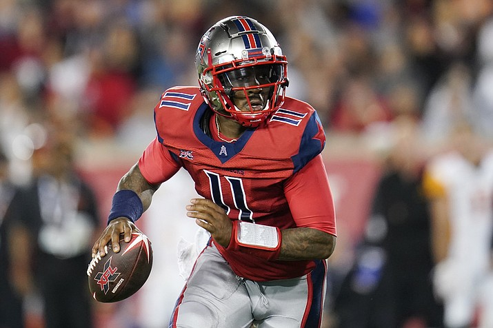 In this Feb. 8, 2020, file photo, Houston Roughnecks quarterback P.J. Walker (11) looks to pass as he scrambles during an XFL football game in Houston. A person familiar with the situation says the Panthers have agreed to terms on contracts with Walker and former Raiders linebacker Tahir Whitehead. The person spoke to the Associated Press on condition of anonymity Monday, March 23, 2020, because the moves have not been announced by the team since the players have yet to pass physicals. (Matt Patterson, AP File)