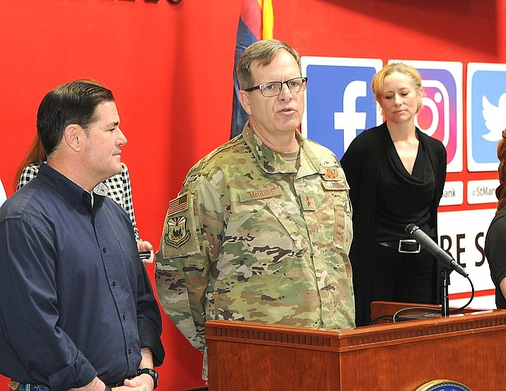 Maj. Gen. Michael McGuire, Friday, with Gov. Doug Ducey and Health Director Cara Christ, saying that National Guard troops would be used largely to help deliver groceries to supermarkets. (Howard Fischer/Capitol Media Services)