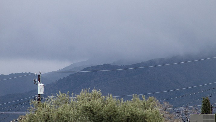 About one-third of an inch of rain fell in Kingman the morning of Monday, March 23. The next chance of showers will be Thursday, March 26. Clouds covered the higher peaks of the Hualapai Mountains Monday afternoon. (Miner file photo)