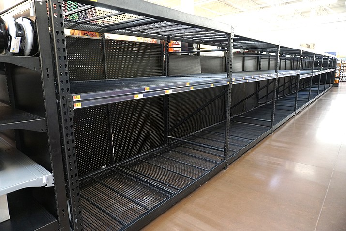 Empty shelves in Winslow at Walmart and Safeway. (Todd Roth/NHO)
