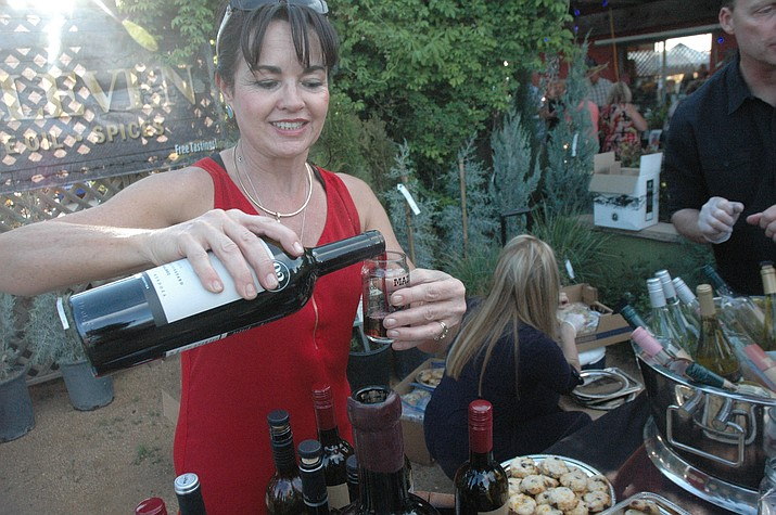 Dawn Wasowicz from Rafter 11 pours some wine at the second annual Wine, Bites and Brew, held at Earthworks Garden Supply Saturday, April 27, 2019. (Jason Wheeler/Review, file)