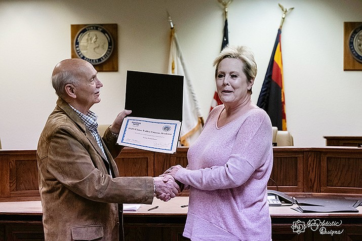 Mayor Darryl Croft shakes Suzy Robertson's hand as he hands her a certificate of completion for the 2020 Chino Valley Citizens Academy during the final session of the program Thursday, March 12, 2020. (Matt Santos/Courtesy)