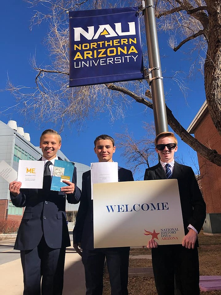 Justin Berry, Gaven Trusty and Kadyn Maynard of the iChoose Academy at Glassford Hill Middle School. On Saturday, March 21, 17 students from the iChoose Academy at Glassford Hill Middle School competed in the National History Day (NHD) Arizona State Finals. (HUSD/Courtesy)