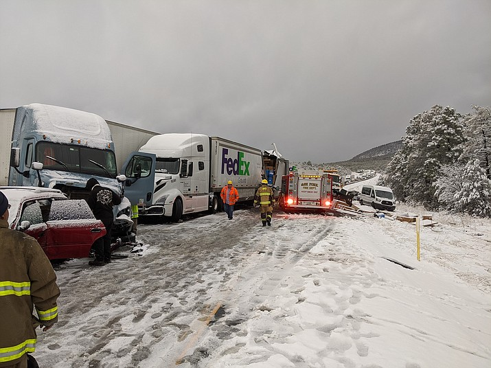 A swift-moving winter storm rolled through Williams the evening of March 18 causing a multiple vehicle accident near Devil Dog exit on I-40. (Photos/Williams Fire)