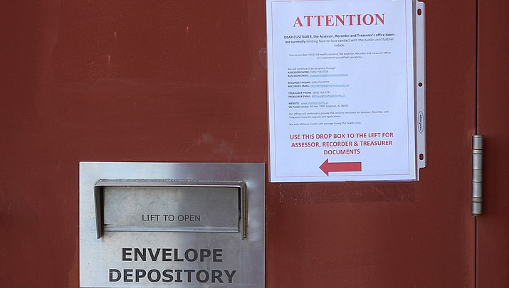 Residents are encouraged to use the drop box at the Mohave County Administration Building, 700 W. Beale St., to help avoid face-to-face interactions due to coronavirus concerns. (Photo by Agata Popeda/Kingman Miner)