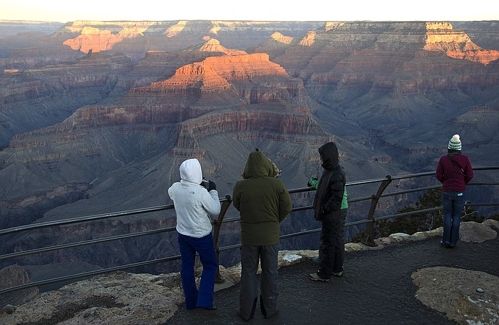 Visitors enjoy a sunrise at Grand Canyon National Park. Most national parks are remaining open during the outbreak of the new coronavirus, but many are closing visitor centers, shuttles, lodges and restaurants in hopes of containing its spread. (Photo/NPS)