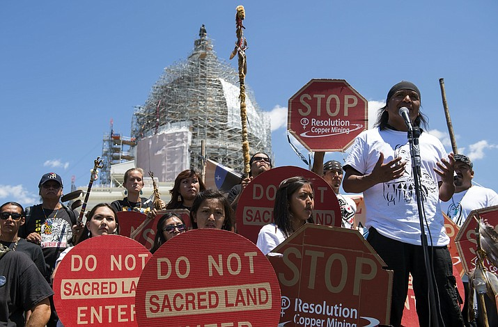 Wendsler Nosie, Sr. speaks with Apache activists in a rally to save Oak Flat, in front of the U.S. Capitol in Washington in July 2015. The land sits on top of a large copper deposit and Resolution Copper Mine enlisted the help of Sen. John McCain. McCain, R-Arz., who attached a provision into a defense bill in December 2014 that transferred 2,400 acres of federal land to them in exchange for 5,300 acres of land owned by the company. (AP Photo/Molly Riley)