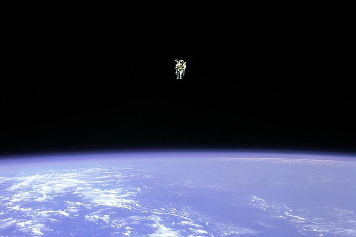 """In this Feb. 12, 1984 photo made available by NASA, astronaut Bruce McCandless uses a nitrogen jet-propelled backpack, a Manned Manuevering Unit, outside the space shuttle Challenger. Astronaut wannabe Rachel Zimmerman-Brachman, a public engagement specialist at NASA's Jet Propulsion Laboratory, says that isolation is a lot like astronaut training. On Thursday, March 19, 2020, she wrote on Facebook, """"Attitude is everything: I'm on an adventure in a confined space with a small crew for a long duration mission, with occasional space walks and resupply missions.  Sounds like astronaut training to me."""" (NASA via AP)"""