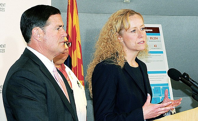 "State Health Director Cara Christ, right, said Wednesday that the number of Arizonans diagnosed with -- and dying -- from COVID-19 will continue to increase for at least the next month. Gov. Doug Ducey, left, said decisions about which types of businesses are essential are ""not going to be political decisions .. and they're not going to be guesses.'' (Capitol Media Services file photo by Howard Fischer)"