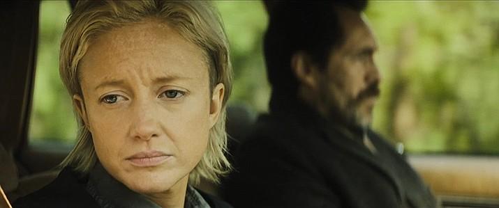 Demián Bichir and Andrea Riseborough in 'The Grudge.' Screen Gems