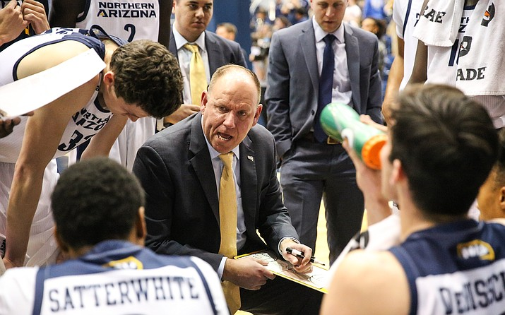 Then-interim head coach Shane Burcar draws up a play for the NAU men's basketball team during a timeout in the 2019-20 season. (Maria Saldivar/NAU Athletics)
