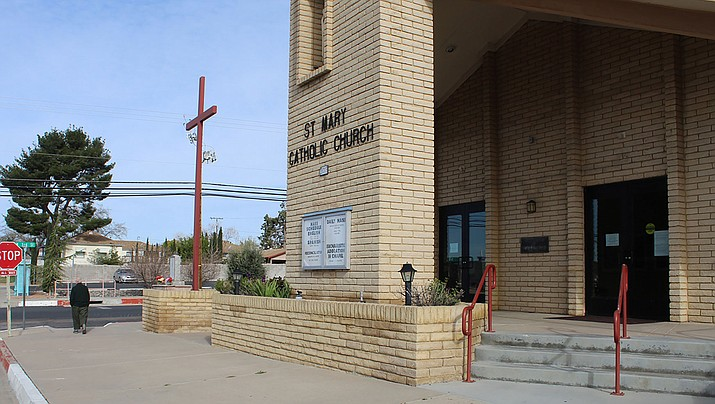 There was plenty of parking at the St. Mary Roman Catholic Church, 301 E. Spring St., on Sunday, March 22. Like many area churches, regular services have been temporarily canceled due to coronavirus concerns, and church services are being offered online. (Photo by Casey Jones/Kingman Miner)