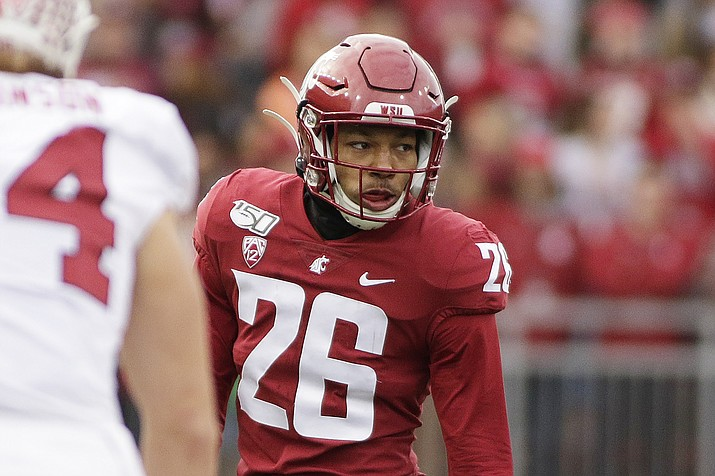 This Nov. 16, 2019, photo shows Washington State defensive back Bryce Beekman (26) during the first half of an NCAA college football game against Stanford in Pullman, Wash. Bryce Beekman has died. Police Cmdr. Jake Opgenorth said Wednesday, Marc 25, 2020, the 22-year-old Beekman was found dead at a residence in Pullman. (Young Kwak/AP, file)